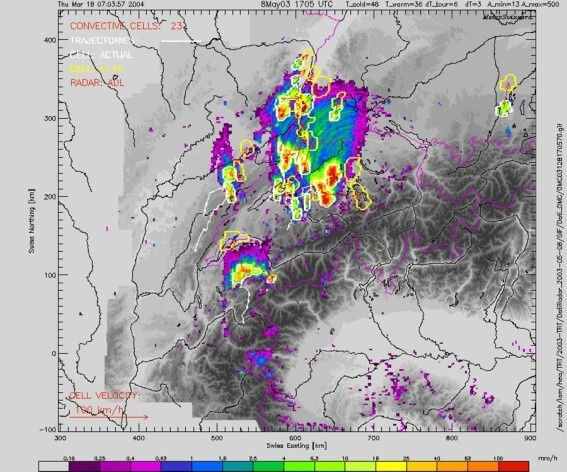 Affichage aggrandi: TRT thunderstorms cells (white contours), trajectories (white lines) and extrapolated cells (+1h, yellow contours), superimposed on the precipitation radar image.